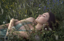 Young Woman Sleeping In Meadow