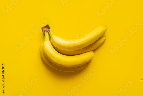 a bunch of bananas on yellow background isolated copy space design mockup b - 251445729