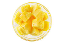Fresh Sliced Pineapple In A Transparent Plate Isolated On White Background