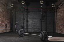 Crossfit Athlete Lifting Barbe...