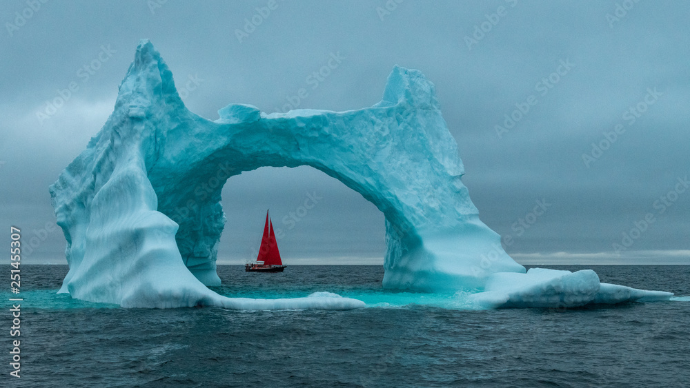 Fototapety, obrazy: Greenland icerberg arch with red sail ship in Disko bay