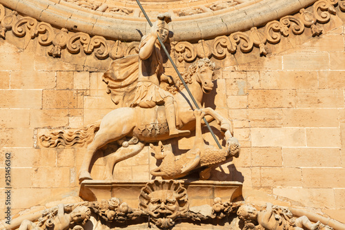 PALMA DE MALLORCA, SPAIN - JANUARY 27, 2019: The St. George statue on the baroque portal of church Iglesia de San Francisco by Pere Horrach and Francisco de Herrera (second half of the 17. cent.).