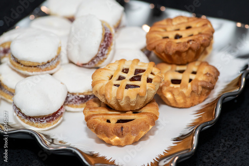 Fotografia, Obraz  Party platter with arranged sweet desserts from a bakery on banquet table at business or wedding event venue