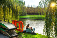 Couple In Love Along River Cam Near Kings College In The City Of Cambridge, United Kingdom
