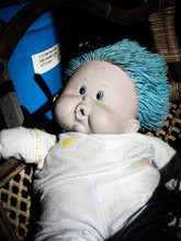 Plastic Blue Eyed Doll With Bl...