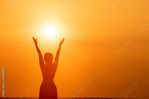 Happy successful fitness woman raising arms to the sky at sunset Canvas Print