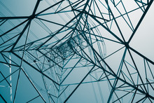 Abstract Pattern From Bottom View Of High Voltage Pole Power Transmission Tower With Clear Sky Sunny Day Background In Monochrome Tone. Green Energy, Environmental Conservation Concept.