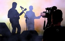 Cameraman Recording And Broadcasting Live Concerts On On Stage Using Video Camera.
