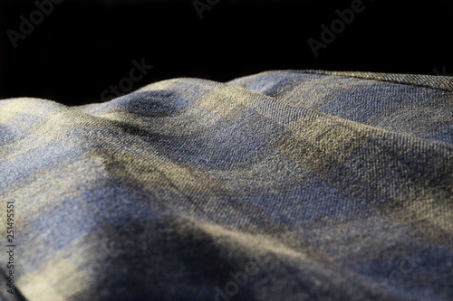 Abstract close up photo of blue and green tartan material in soft sunlight Wallpaper Mural