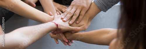 Fotografie, Obraz  Horizontal close up image caucasian people holding stacking hands together