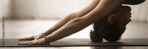 Recess Fitting Yoga school Horizontal photo sportive woman practice yoga doing downward facing dog
