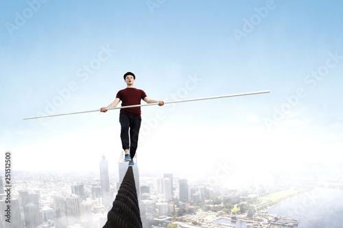 Fotografía  Brave ropewalker on cable. Mixed media