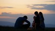 Family silhouette parents and children looking to fire sparkle sunset sky