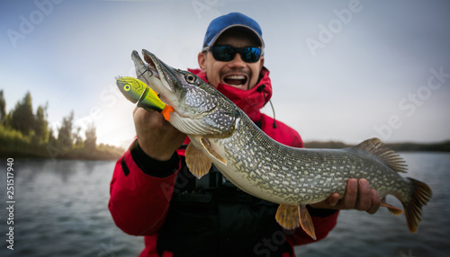 Fishing. Fisherman and trophy Pike. Canvas Print