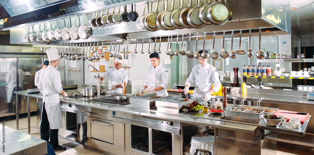 Fototapety, obrazy: Modern kitchen. The chefs prepare meals in the restaurant's kitchen.