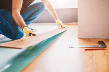 Man At Home Laying Laminate Flooring - Finishing