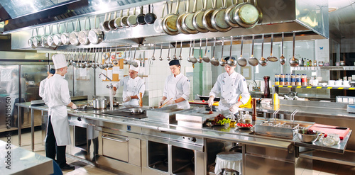 Spoed Foto op Canvas Restaurant Modern kitchen. The chefs prepare meals in the restaurant's kitchen.