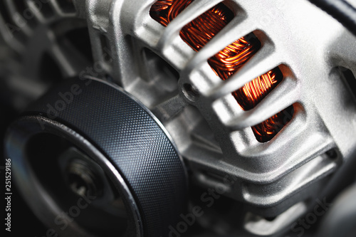 Photo new car alternator, close-up view