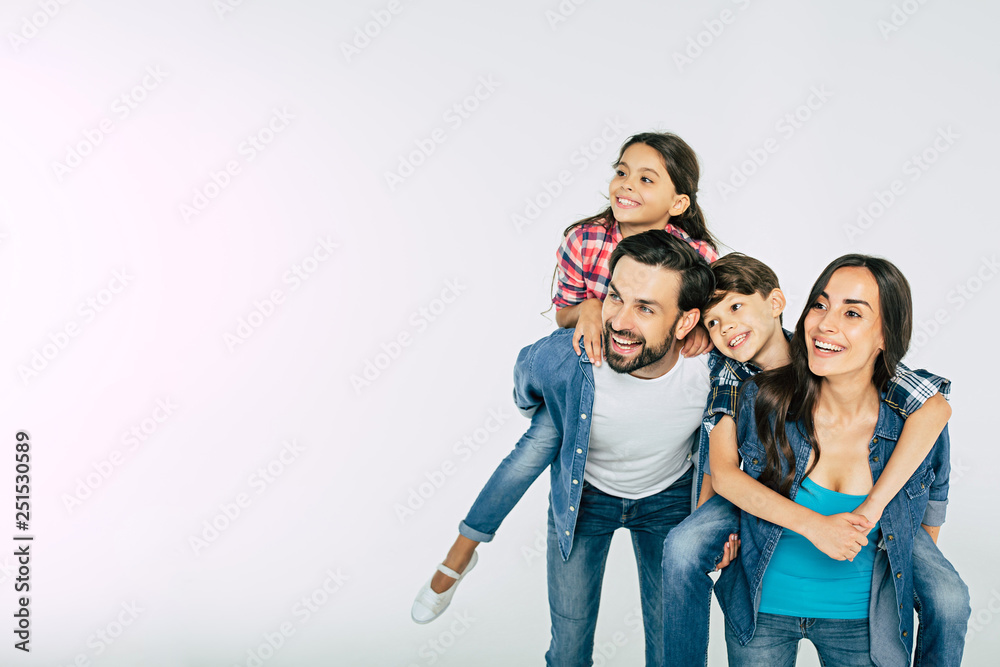 Fototapety, obrazy: Photo of happy beautiful family isolated on white and looking away