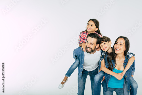 Obraz Photo of happy beautiful family isolated on white and looking away - fototapety do salonu