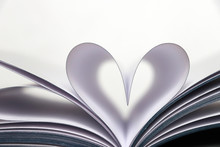 Open Book With Heart Shape From Paper Pages Isolated On White Background. Love Of Reading, Concept Of Science, Learning, Romance