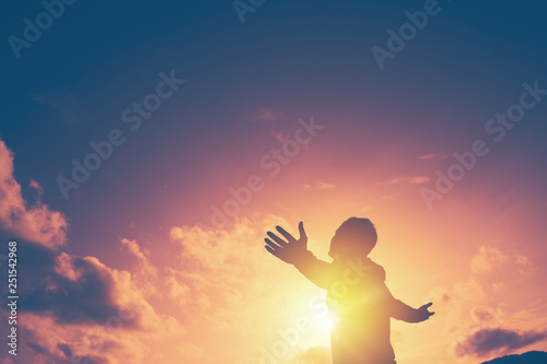 Valokuvatapetti Copy space of man rise hand up on top of mountain and sunset sky abstract background