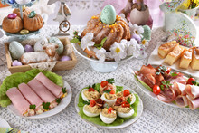Easter Table With Traditional Dishes And Cakes