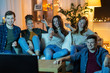 canvas print picture - friendship, leisure, people and entertainment concept - happy friends watching tv at home in evening