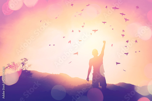Poster Ecole de Yoga Copy space of man rise hand up on top of mountain and sunset sky abstract background.