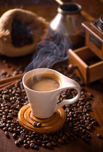 Cup Of Coffee And Coffee Beans In A Sack On Dark Background, Top View
