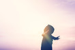 Copy space of happy man raise hands on sunset sky with sun light abstract background.