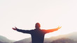 Leinwandbild Motiv Copy space of man rise hand up on top of mountain and sunset sky abstract background.