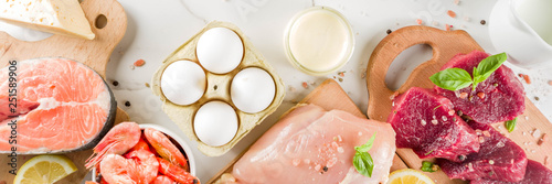 Fototapeta Animal protein sources - raw beef meat steak, chicken breast fillet, salmon fish, eggs, dairy milk, shrimps, cheese, copy space obraz
