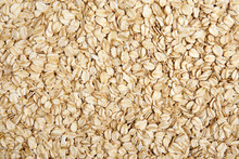 Oat-flakes Texture Background.