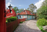 Old wooden houses on narrow historical street in Scandinavian city. Colorful countryside of Gothenburg, Sweden