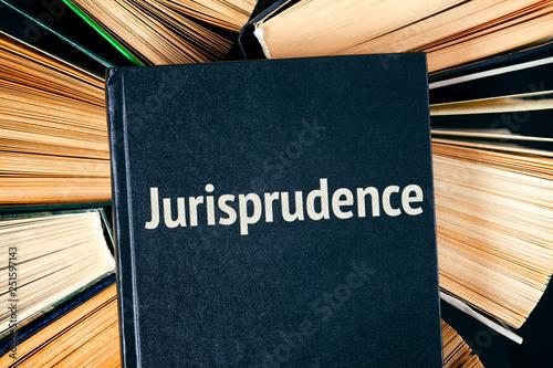 Fényképezés  Old hardback books with book Jurisprudence on top.