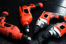Electric Drills Metal Background