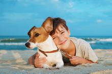 Happy Boy Hugging His Dog Bree...
