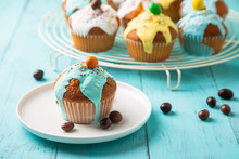 Colorful Glazed Muffins For Kids Party