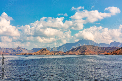 Fototapeta Sea and rocky shores in the fjords of the Gulf of Oman, panoramic view