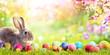 Leinwanddruck Bild - Adorable Bunny With Easter Eggs In Flowery Meadow
