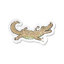 Retro Distressed Sticker Of A Cartoon Crocodile