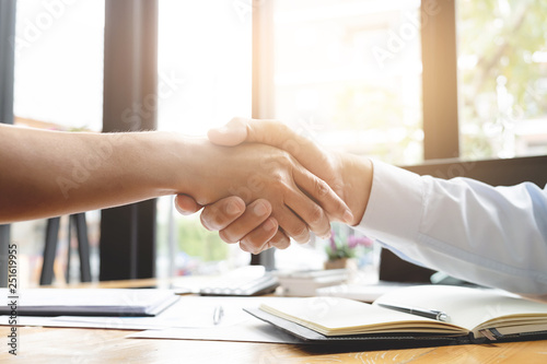 Photo recruitment and interview concept , candidate with human resource manager handshaking