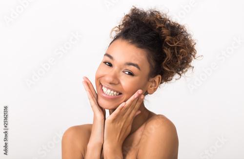 Valokuvatapetti African-american woman without make-up on light background