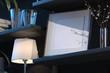 Blank photo frame on wooden shelf in dark living room. 3d rendering.