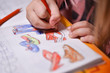 The child paints over pencils pictures coloring shoes