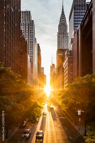 Sunset light shining on the buildings and cars on 42nd Street in Midtown New Yor Canvas Print