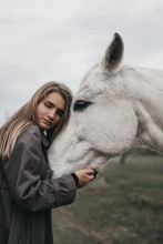 Young Woman Embracing Horse