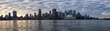 Vancouver, BC, Canada - December 24, 2018: Panoramic view of a modern downtown city during a vibrant winter sunset.