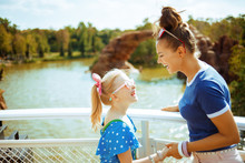 Mother And Daughter Travellers Having Fun Time While River Cruis